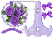 Pretty purple roses on lace with bows on a plate & stand