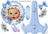 Baby in bonnet with blue bow on a plate & stand