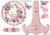 white kitten with flowers on a plate & stand with bow