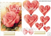 Pretty pink roses with heart pyramids and bow
